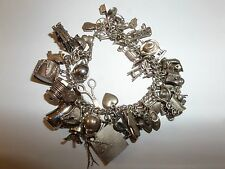 VINTAGE STERLING SILVER CHARM BRACELET ABOUT 47 CHARMS 84.7 GRAMS WOW