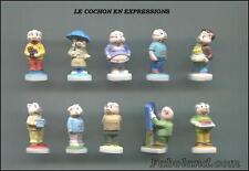 Feves  NEW  LE COCHON EN EXPRESSIONS  10 Sujets  Porcelaine 3 cm. environ  ND