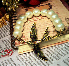 Vintage style bird and pearl charm stretch bracelet
