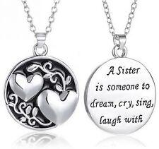 Collier, pendentif double coeurs avec message destiné a une soeur.