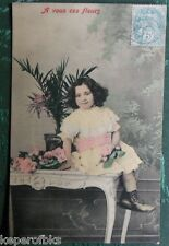 VICTORIAN GIRL SITS on TABLE COLORED ANTIQUE FRENCH REAL PHOTO POSTCARD