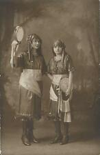 TWO TEENAGE GYPSY GIRLS PREPARE FOR CARNIVAL -CHALON SUR SAONE, FRANCE- RPPC