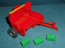 "ERTL HAY BALER no. 1754A  7"" LONG  WHEEL BASE  IS 4"" WIDE"