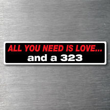 All you need is a 323  sticker quality 10 year water/ fade proof vinyl Mazda