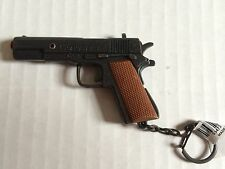 Pistol 45 Auto Miniature Replica  Firing caps Key Chain NEW MADE OF METAL & PLAS
