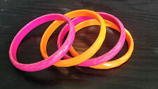 Set of 4 slim faceted plastic bangles -- neon orange and raspberry pink