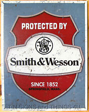 Protected by Smith and Wesson TIN SIGN gun ammo vtg metal hunt garage decor 1682