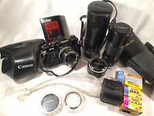 Canon F-1 35mm SLR Film Camera Bundle w/ 3 lenses, Tripod, Film & More! - USED -