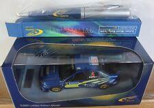 SUBARU WRC 2005 PETER SOLBERG AVEC DEDICACE ET STYLO 1/43 IXO PRODRIVE