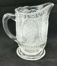 Vintage 11.5cm tall, 11cm wide across handle, 6cm body, clear pressed glass jug