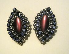 Wonderful clip-on earrings in an oval design with brown centre & white stone