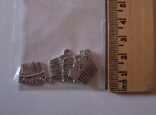Craft supply bag - 4 small silver Victorian hair comb charms real tines!