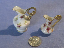 Vintage pair of porcelain dollhouse pitchers in floral pattern