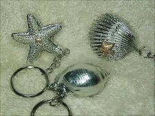 2 bomboniera per matrimonio, portachiavi con conchiglie e stella marina