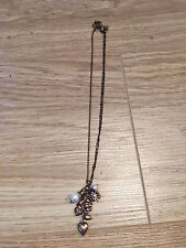 Vintage looking short copper necklace heart, key, clover charms & pearl. TOPSHOP