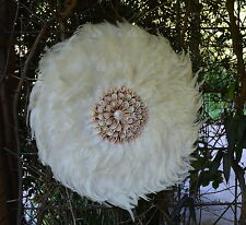 Juju hat. Round White feather & Spiral Shell wall feature art.