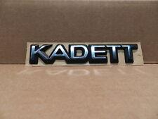 Emblem KADETT chrom/schwarz Kadett E  ORIGINAL OPEL 129494