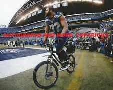 MICHAEL BENNETT SEATTLE SEAHAWKS 8x10 PHOTO - RIDES POLICE BIKE AFTER GAME