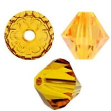 Swarovski Crystal Bicone Sunflower Color. 6mm. Approx. 48 PCS. 5328