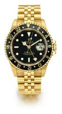 ROLEX | AYELLOW GOLD AUTOMATICDUAL TIME ZONE CENTER SECONDS WRISTWATCH WITH...
