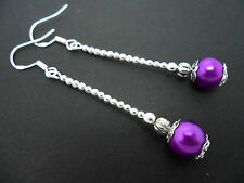 A PAIR OF LONG PURPLE GLASS PEARL EARRINGS WITH 925 SOLID SILVER HOOKS. NEW..