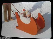 old vintage Christmas 1974 cold baby sleeps in red Santa snow sled sleigh PHOTO