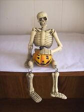 """Skeleton with Jack O' Lantern"" Shelf Sitter Skeleton Figure with Dangle Legs"