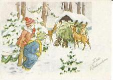 La navidad, niños que observar ciervos y los conejos en la futterkrippe