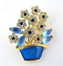 NEW RUCINNI BLUE CLEAR SWAROVSKI CRYSTALS FLOWER IN POT PIN BROOCH IN GOLD TONE