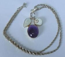 SILVER  PENDANT SET WITH GEMSTONES ON 19 INCH SILVER CHAIN