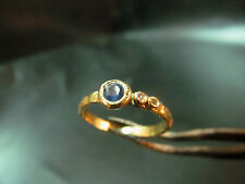 14K handmade yellow gold ring set with Sapphire. On the side sets 2 diamond