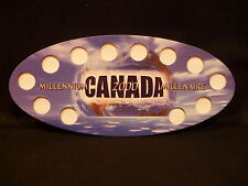 CANADA :2000  MILLENNIUM  25 CENT SOUVENIR OVAL GLOBAL  HOLDER  (#7)