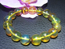 Ref.# 800-Dominican Blue-Green Amber Bracelet Beads about 11.5 mm spheres(14 g)