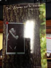Original polaroid of Johnny RAMONE JOE STRUMMER w/ signed book by Mescaleros