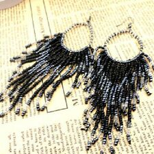 Massive black and silver seeded pearl chandelier tassel earrings