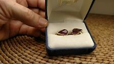 Elegant Signed Christian Dior Gold Clip Earrings with Amethyst Stones