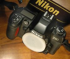Nikon F80 Film camera body only. Exc cond. Bookle. Body cap and Nikon strap