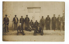 WORKING MEN with Bicycles outside factory - RPPC  Postcard - LANGUAGE?