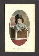 TINTED REAL-PHOTO POSTCARD:  BABY WEARING TOP HAT WITH CIGAR, IN A BOX - Unused