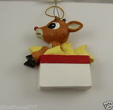 Christmas ornament Rudolph red nosed reindeer in present.