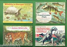 #T9. FOUR BROOK  BOND CARD ALBUMS, FISH, WILDLIFE, PREHISTORIC ANIMALS, etc