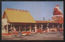 Postcard SANTA CLAUS CA  Toyland w/Pedal Cars/Wagons/Baby Doll Carriages 1950's