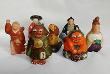 Unusual and scarce collection of seven Japanese low fire ceramic dolls