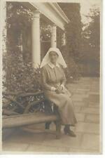 NURSE SITTING ON A RUSTIC BENCH IN THE GARDEN OLD PHOTO POSTCARD