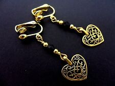 A PAIR OF GOLD COLOUR DANGLY HEART  CLIP ON EARRINGS. NEW.