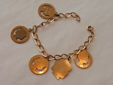 Vintage gold filled charm bracelet with 5 child themed charms