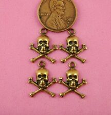 SM ANT BRASS SKULL AND CROSSBONES-- W/ RING- 4 PC(s)