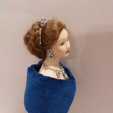 MINIATURE LADY DOLL DRESSED IN A BLUE GOWN WITH BEAUTIFUL JEWELRY