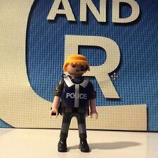 PLAYMOBIL FIGURA CITY POLICÍA 50 - 10/12/14