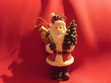 X05   SANTA TREE ORNAMENT HOLDING A TREE AND BAG OF TOYS